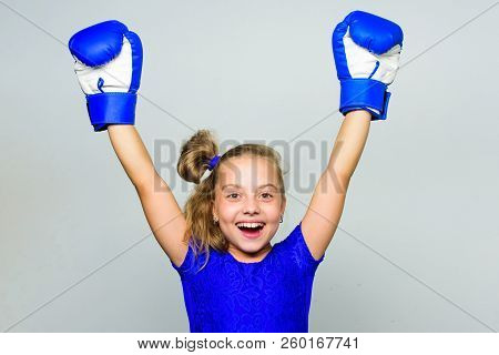 Strong Child Proud Winner Boxing Competition. Girl Child Happy Winner With Boxing Gloves Posing On G
