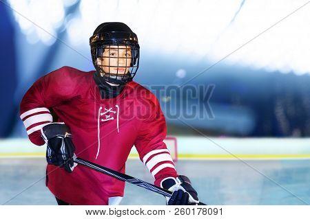 Portrait Of Teenage Boy Playing Ice Hockey