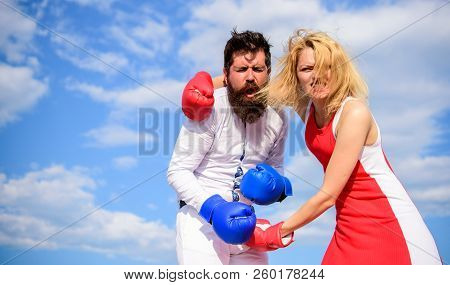 Struggle For Gender Equality. Attack Is Best Defence. Man And Woman Fight Boxing Gloves Sky Backgrou