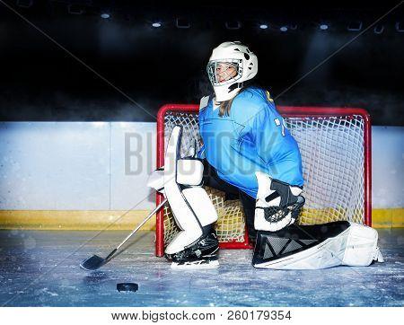 Girl Goaltender Protecting Net During Hockey Match