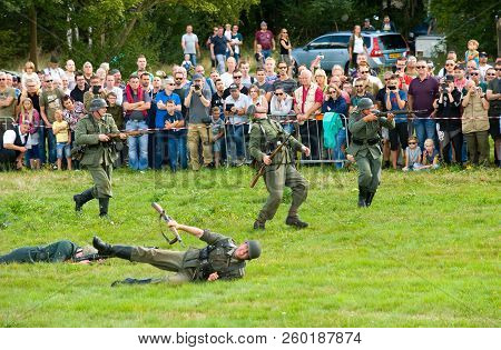 Enschede, The Netherlands - 01 Sept, 2018: German Soldiers Fighting And Shooting During A Military A