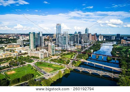 High Above City Downtown Austin Skyline Cityscape From Butler Park Green Space Pond Water Symmetry S