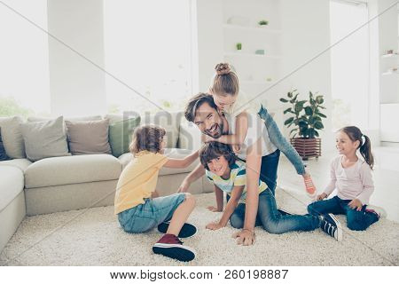 Relax, Rest, Careless, Carefree Concept. Family With Four Children And One Parent Comfort Play Neat
