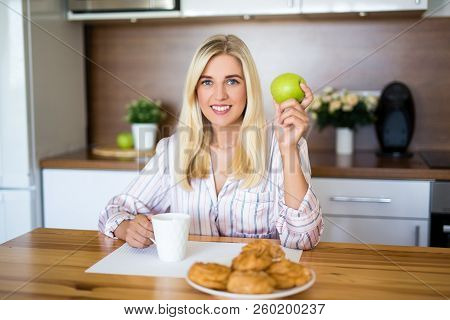 Breakfast Or Coffee Break Concept - Portrait Of Woman Eating At Home