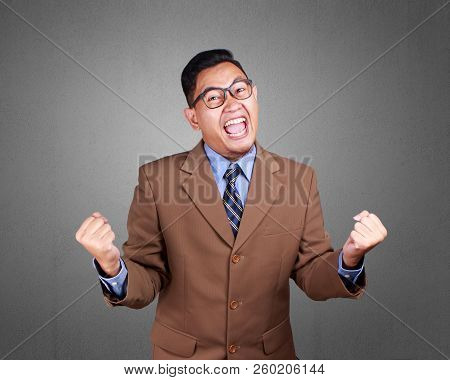 Young Businessman Winning Gesture