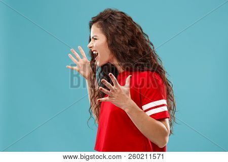 Screaming, Hate, Rage. Crying Emotional Angry Woman Screaming On Blue Studio Background. Emotional,