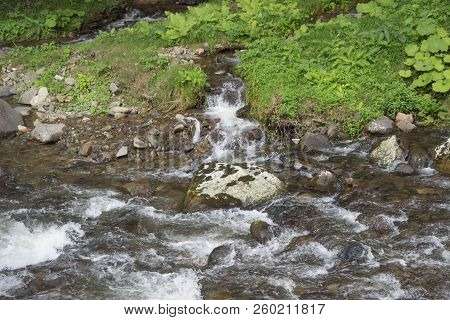 Mountain River In Resort Sairme. Beautiful River Clear Water Flowing Through Stones. Clean Mountain