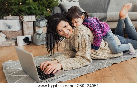Indoor Shot Of Beautiful Happy Young Woman Shopping Online On Laptop In Cozy Christmas Interior. Mot