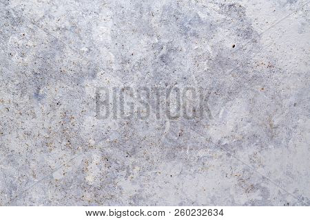 Gray metal surface, rusty metal background with traces of exploitation. Grunge metal texture.