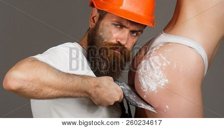 Bearded Man Worker, Beard. Female Ass In Underwear. Plastering Tools. Naked Body. Big Ass, Gorgeous