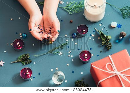 festive christmas decor background. seasonal design with holiday adornments and embellishments. gift box and candles on blue backdrop. poster