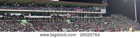 CLUJ-NAPOCA, ROMANIA - FEBRUARY 28: Panoramic view of supporters at a Romanian National Championship soccer game CFR Cluj vs. Steaua Bucuresti, February 28, 2010 in Cluj-Napoca, Romania.