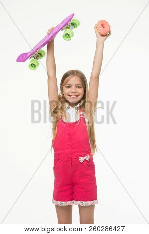 Kid Girl Relax Hold Penny Board. Active Leisure Concept. Girl Raise Up Penny Board And Sweet Donut O