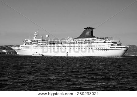 Patmos, Greece - April 19, 2010: Cruise Ship Or Liner In Blue Sea. Passenger Ship On Sunny Sky. Summ
