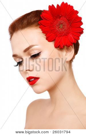 Portrait of young beautiful woman with stylish make-up and red gerbera on white background poster