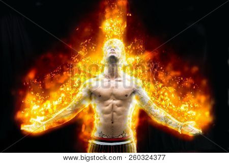 Shirtless Young Man Burning In Bright Fire