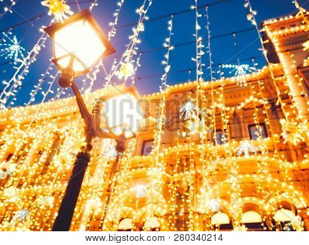 Bright Christmas Street Illumination On The Facade Of The Buildings. The City Is Decorated For The C