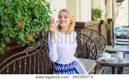 Enjoy every moment of your life. Girl sit cafe sniff flowers aroma. Beautiful terrace attract clients. Plants as natural decoration. Woman sit cafe terrace enjoy flower fragrance. Woman wait date poster