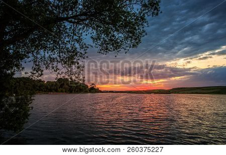 Beautiful Lake And Forest During Sunset. Landscape Nature.