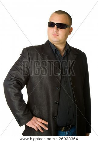Man in black suit in sun glasses. Isolated on white background