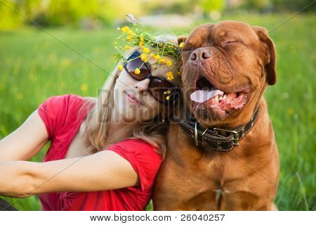 Young girl and her dog (French mastiff, Dogue de Bordeaux) poster