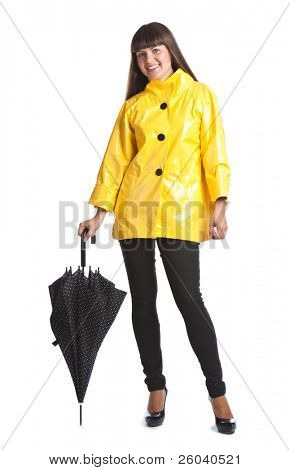 Young woman with umbrella. Isolated on white background