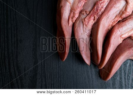 Raw Pork Or Beef Tongues On Black Wooden, Gourment Food