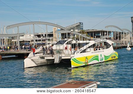 BARCELONA, SPAIN - APRIL 15, 2018: Eco Slim, Europe's largest ecological catamaran, docks at Port Vell. The electric powered tourist vessel makes use of wind and solar energy.