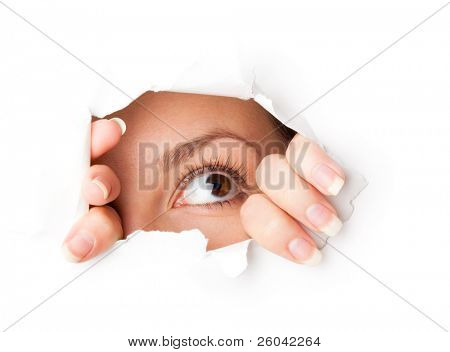 Eye looking through hole. Isolated on white background