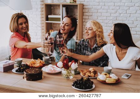 Happy Old Women Celebrate 8 March. Drinking Wine. Romantic Day With Family. Wine And Cake. Spring Wi