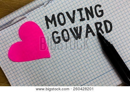 Text sign showing Moving Goward. Conceptual photo Towards a Point Move on Going Ahead Further Advance Progress Squared notebook paper ripped sheets Marker romantic ideas pink heart. poster