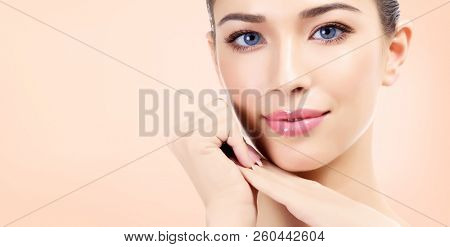 Pretty woman with clean and fresh skin is smiling to you. Beautiful girl portrait