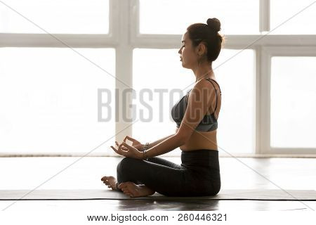 Young Sporty Yogi Woman Practicing Yoga, Doing Easy Seat Exercis