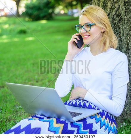 Buy Clothes Online. Girl Sit Grass With Notebook. Woman With Laptop In Park Order Item On Phone. Gir