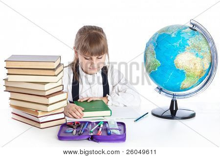 Girl is doing homework. Isolated on white background