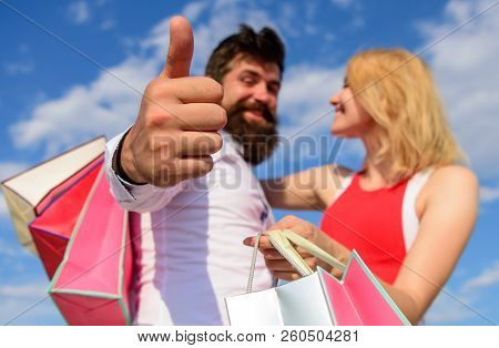 Advice Shop Now. Couple With Shopping Bags Cuddle Blue Sky Background. Man With Beard Shows Thumb Up