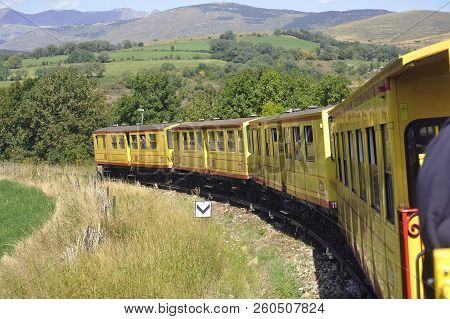 Latour De Carol, France - September 4, 2018: The Small Yellow Trains Of The Pyrenees Crossing A Beau