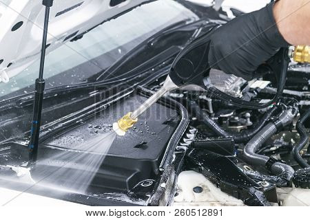 Car Detailing. Manual Wash Engine With Pressurized Water. Washing Car Engine With Water Nozzle. Car