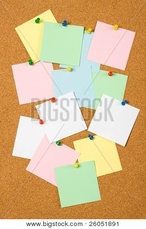 Cork notice board with blank paper notes