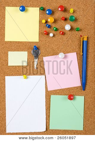 Blank memo notes pinned on cork notice board