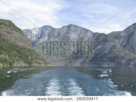 Landscape With Naeroyfjord And High Mountains In Norway