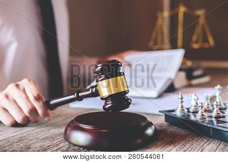 Male Lawyer Or Judge Working With Law Book, Gavel And Balance, Report The Case On Table In Office, L