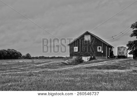 This Is An Image Of A Barn In Black And White