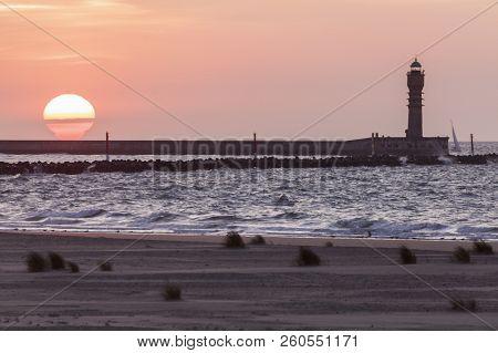 Feu De Saint-pol Lighthouse In Dunkirk At Sunset. Dunkirk, Hauts-de-france, France.