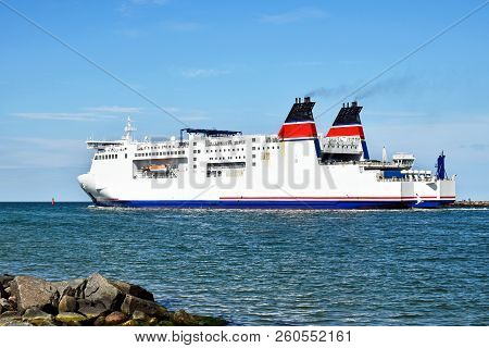 A Large Ferry Leaves The Port And Goes Out To Sea