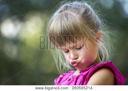 Close-up Portrait Of Pretty Funny Moody Young Blond Preschool Child Girl In Pink Sleeveless Dress Fe