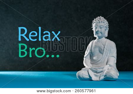 Relaxed buddha figurine sitting and meditating, doing yoga exersice. Relax bro - inscription poster