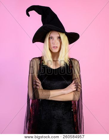 Halloween&autumn Holiday Concept. Woman In Black Witch Hat, Dress And Serious Face. Witch Costume. W