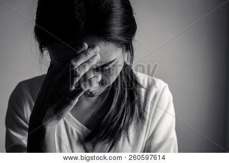 Depressed And Stressed Woman Sitting On The Floor Alone Head In Hands In The Dark Room