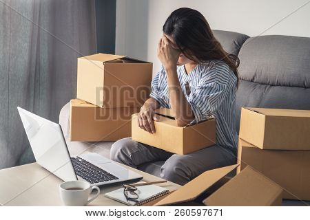 Stressed And Frustrated Asian Business Woman Holding Head In Hands And Working, Business Failure Con